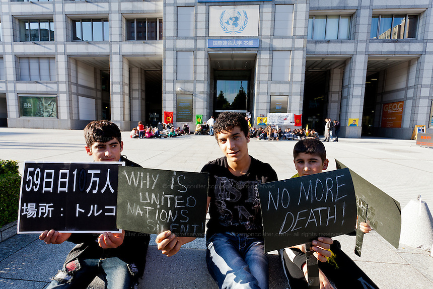 Young Kurdish hunger strikers outside the United Nations University in Omote Sando, Tokyo, Japan. Friday November 9th 2012. The strike lasted from 8am to 8pm to show solidarity with nearly 800 Kurdish political prisoners held in Turkey who have been on hunger strike for 2 months