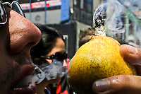 A man smokes marijuana in a pear during a demonstration in support for legalization of marijuana in Bogota, May 4, 2013. Photo by Freddy Builes / VIEWpress.