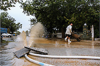 A hose pumps out flood water in Nea Mihaniona