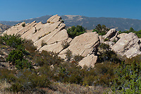 A view of  rocks protruding from the ground at Vasquez Rocks.