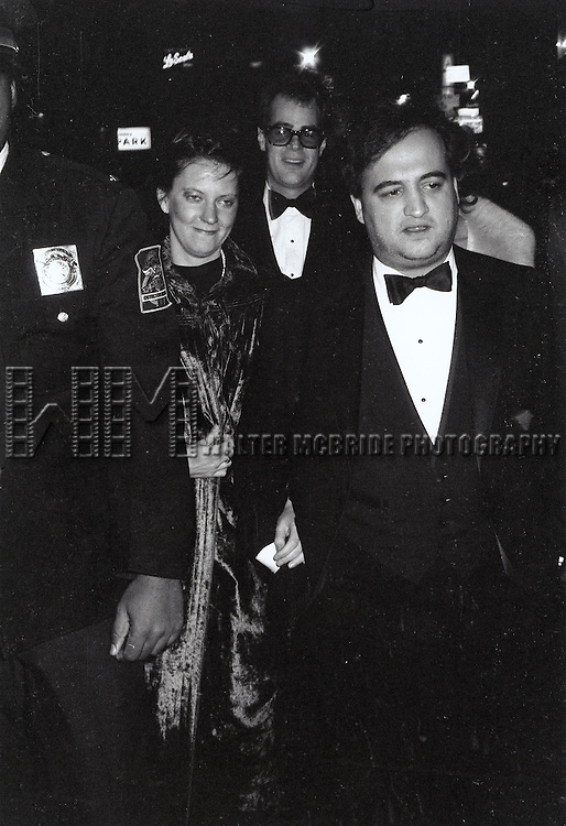 © WALTER McBRIDE / , USA...JOHN BELUSHI AND HIS WIFE JUDY AND.GOOD FRIEND DAN AYKROID.(EARLY 1980'S).STAR OF SAT. NITE LIVE.NEW YORK CITY.CREDIT ALL USES