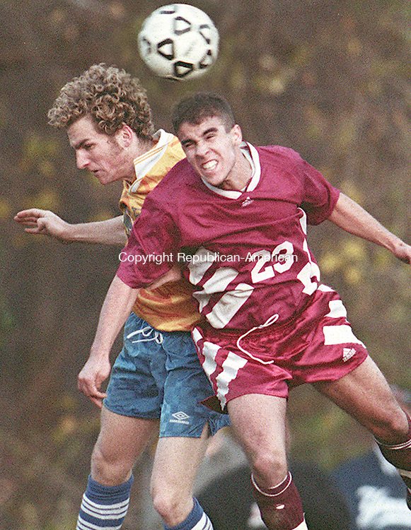 SEYMOUR,CT-11/02/98-1102CK01.tif-Seymour's Mike Fritz and Naugatuck's Albino Texeira fight for a ball using only their heads during their game in Seymour on Monday.   CASEY KEIL PHOTO.