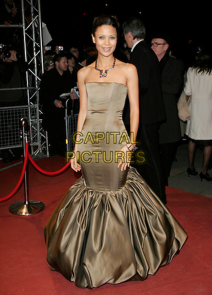 THANDIE NEWTON.The Orange British Academy Film Awards (BAFTA's) aftershow, The Grosvenor House Hotel, London, UK..February 11th, 2007.full length strapless gold fishtail dress .CAP/AH.©Adam Houghton/Capital Pictures