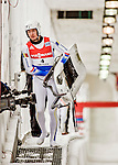 4 December 2015: Cosmin Atodiresei, sliding for Romania, carries his sled after crossing the finish line of his second run with Stefan Musei, finishing 18th for the day with a combined time of 1:29.880 in the Doubles Competition of the Viessmann Luge World Cup at the Olympic Sports Track in Lake Placid, New York, USA. Mandatory Credit: Ed Wolfstein Photo *** RAW (NEF) Image File Available ***