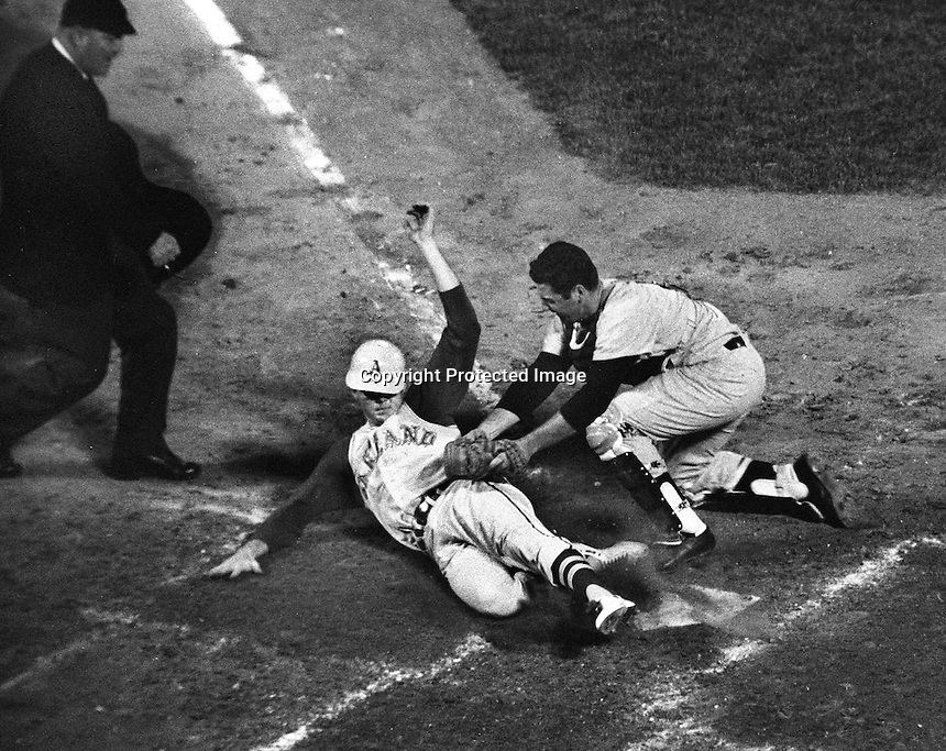 A's vs. Yankee's 1968. Yankee catcher #41 tags out .A's runner at home. Ron Riesterer/photo