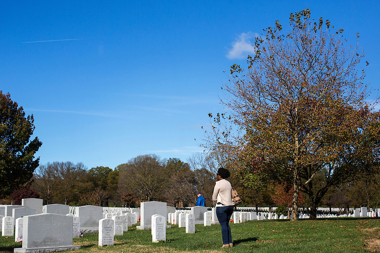 UNITED STATES - NOVEMBER 11 - A woman stands alone after leaving flowers at the grave of U.S. Army Major General Harold Greene during Veterans Day at Arlington National Cemetery, in Arlington, Va., Wednesday, November 11, 2015. Greene, who was killed in 2014, was the highest-ranking U.S. Army officer killed in combat since the Vietnam War. (Photo By Al Drago/CQ Roll Call)