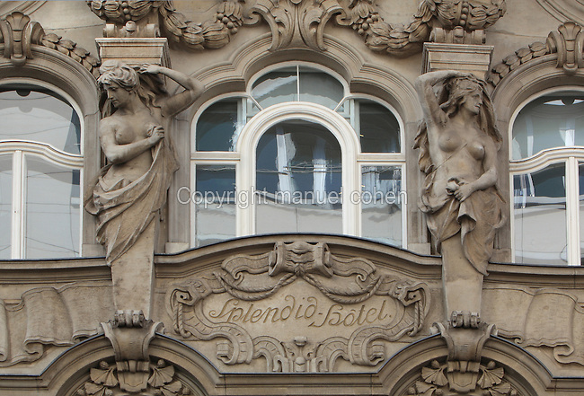 Sculpted female caryatid figures flanking a window on the Splendid Hotel building, erected 1904 in Neo-Baroque style with art nouveau elements, on Dorotheenstrasse, Mitte, Berlin, Germany. The building is now a delicatessen and travel agent. Picture by Manuel Cohen