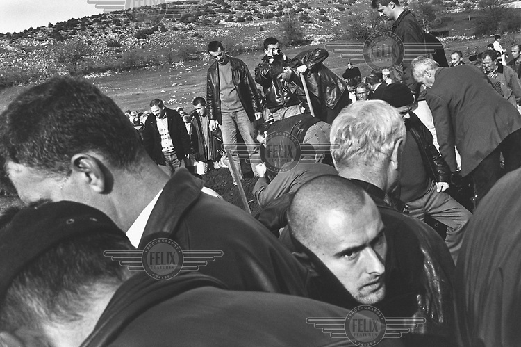 ©Paul Lowe/Panos Pictures..BOSNIA Novoseoci-sokolac 2000..The funeral of 42 Bosnian Muslims killed by Serbians on 22/9/1992, whose bodies were then buried in a rubbish dump and later discovered and exhumed this  year (2000) by the Bosnian commission for missing persons.