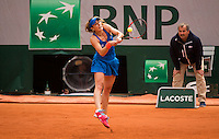 Alize Cornet of France in action at Roland Garros