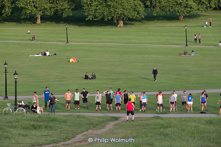 Exercise group workout, Primrose Hill, London.