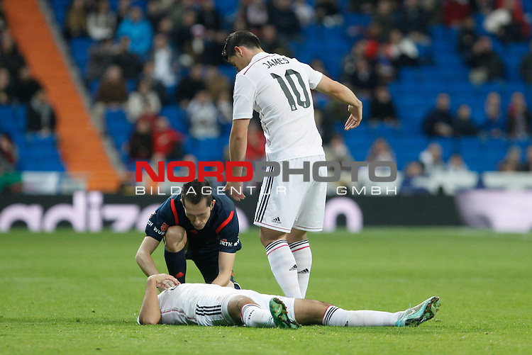 Real Madrid¥s James Rodriguez calls the medical services after Sami Khedira got injured during Spanish King Cup match between Real Madrid and Cornella at Santiago Bernabeu stadium in Madrid, Spain. May 26, 2013. Foto © nph / Victor Blanco)