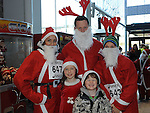 Alison Fernandes, Neil, Martina, Rosie and Connor Kelly who took part in the Santa Run at Scotch Hall. Photo: Colin Bell/pressphotos.ie