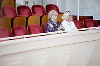 USA International Harp Competition Vice President Linda Wood Rollo, left, and Founder and Artistic Director Susann McDonald watch a performance during Stage III at the 11th USA International Harp Competition at Indiana University in Bloomington, Indiana on Wednesday, July 10, 2019. (Photo by James Brosher)