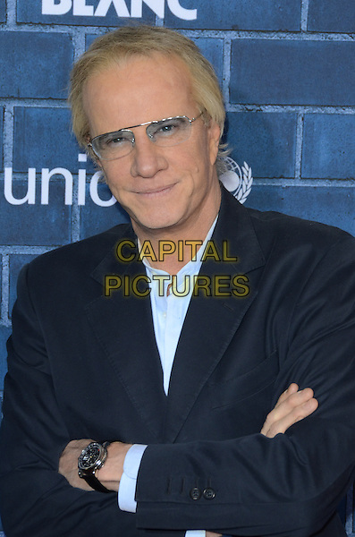 Christopher Lambert.Montblanc Hosts Pre-Oscar Charity Brunch Benefiting UNICEF held at Hotel Bel-Air, Los Angeles, California, USA..February 23rd, 2013.half length black blue suit shirt arms crossed glasses .CAP/ADM/TW.©Tonya Wise/AdMedia/Capital Pictures