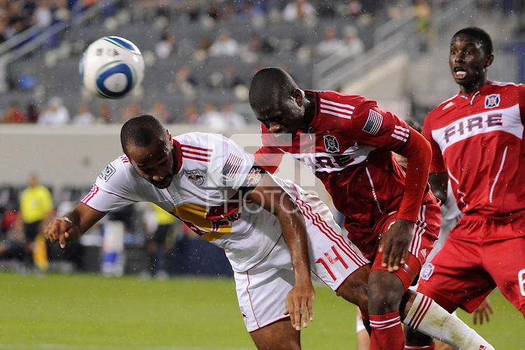 Thierry Henry (14) of the New York Red Bulls heads the ball as Yamith Cuesta (89) of the Chicago Fire defends. The New York Red Bulls and the Chicago Fire played to a 2-2 tie during a Major League Soccer (MLS) match at Red Bull Arena in Harrison, NJ, on August 13, 2011.