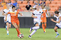 Houston, TX - Saturday July 08, 2017: Carli Lloyd brings the ball up the field around Celeste Boureille during a regular season National Women's Soccer League (NWSL) match between the Houston Dash and the Portland Thorns FC at BBVA Compass Stadium.
