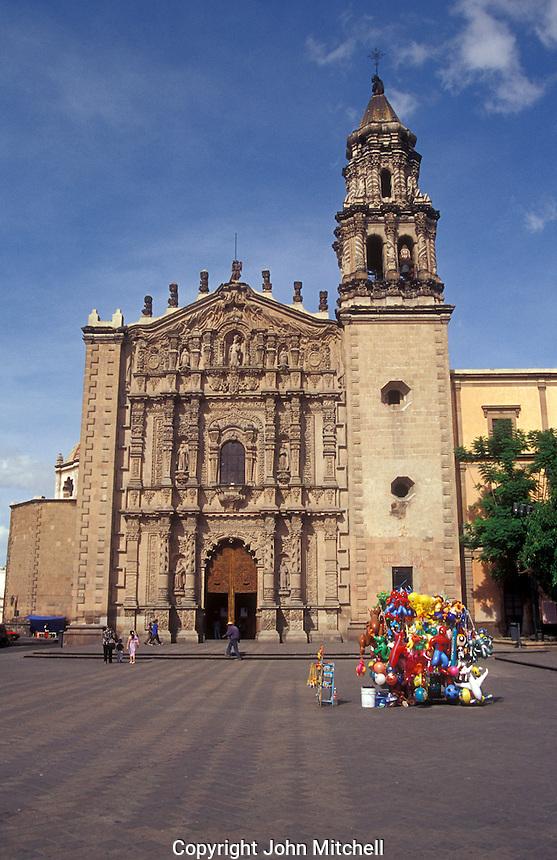 The baroque-style facade of the Templo de Carmen church on the Plaza del Carmen in the city of San Luis Potosi, Mexico