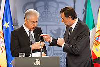 Mario Monti and Mariano Rajoy converse effusively