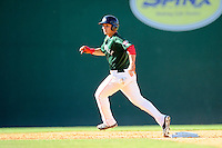 Right fielder Nick Longhi (21) of the Greenville Drive runs the bases in a game against the Charleston RiverDogs on Sunday, June 28, 2015, at Fluor Field at the West End in Greenville, South Carolina. Longhi is the No. 27 prospect of the Boston Red Sox, according to Baseball America. Charleston won, 12-9. (Tom Priddy/Four Seam Images)