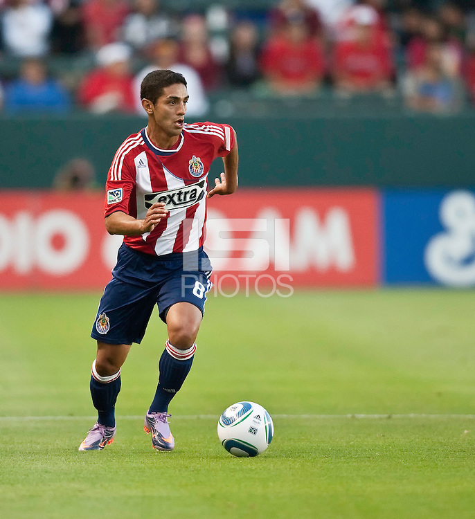 Chivas USA defender Mariano Trujillo (8) pushes the ball up the pitch during the first half of the game between Chivas USA and the Philadelphia Union at the Home Depot Center in Carson, CA, on July 3, 2010. Chivas USA 1, Philadelphia Union 1.
