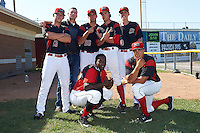 Batavia Muckdogs pitchers Shane Sawczak (33), Sam Perez (no uniform), Michael Mertz (26), Dustin Beggs (47), Hunter Wells (40), Ty Provencher (kneeling - right) and outfielder Isaiah White (kneeling - left) after a game against the Auburn Doubledays on September 5, 2016 at Dwyer Stadium in Batavia, New York.  Batavia defeated Auburn 4-3. (Mike Janes/Four Seam Images)