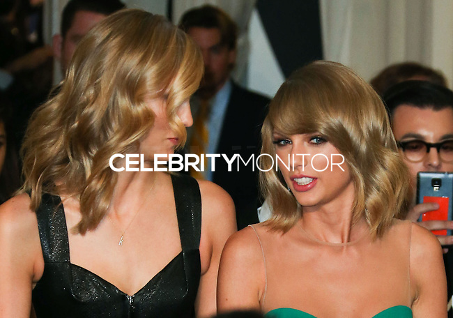 LOS ANGELES, CA, USA - NOVEMBER 23: Karlie Kloss, Taylor Swift pose in the press room at the 2014 American Music Awards held at Nokia Theatre L.A. Live on November 23, 2014 in Los Angeles, California, United States. (Photo by Xavier Collin/Celebrity Monitor)