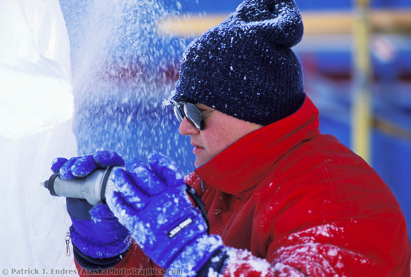 Ice sculptor with grinding tool, World Ice Sculpting Championships, Fairbanks, Alaska