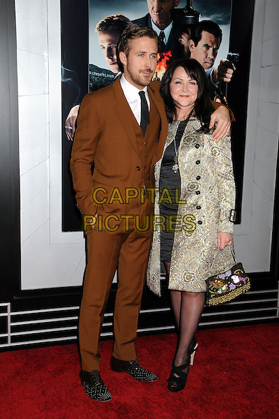 "Ryan Gosling & Donna Gosling.""Gangster Squad"" Los Angeles Premiere held at Grauman's Chinese Theatre, Hollywood, California, USA..January 7th, 2013.full length white shirt beard facial hair brown camel suit black tie grey gray son mother mom mum family floral print coat jacket arm over shoulder waistcoat .CAP/ADM/BP.©Byron Purvis/AdMedia/Capital Pictures."