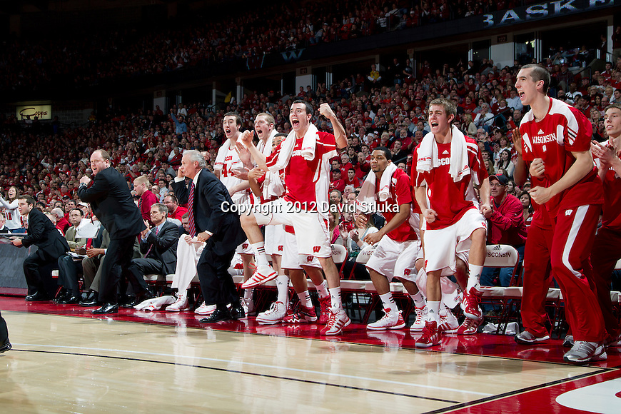 Wisconsin Badgers teammates cheer during a Big Ten Conference NCAA college basketball game against the Illinois Fighting Illini on Sunday, March 4, 2012 in Madison, Wisconsin. The Badgers won 70-56. (Photo by David Stluka)