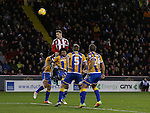 Billy Sharp of Sheffield Utd rises up above the Shrewsbury defence during the English League One match at the Bramall Lane Stadium, Sheffield. Picture date: November 19th, 2016. Pic Simon Bellis/Sportimage