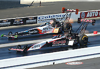 Feb 13, 2016; Pomona, CA, USA; NHRA top fuel driver Steve Torrence (near) races alongside Clay Millican during qualifying for the Winternationals at Auto Club Raceway at Pomona. Mandatory Credit: Mark J. Rebilas-USA TODAY Sports