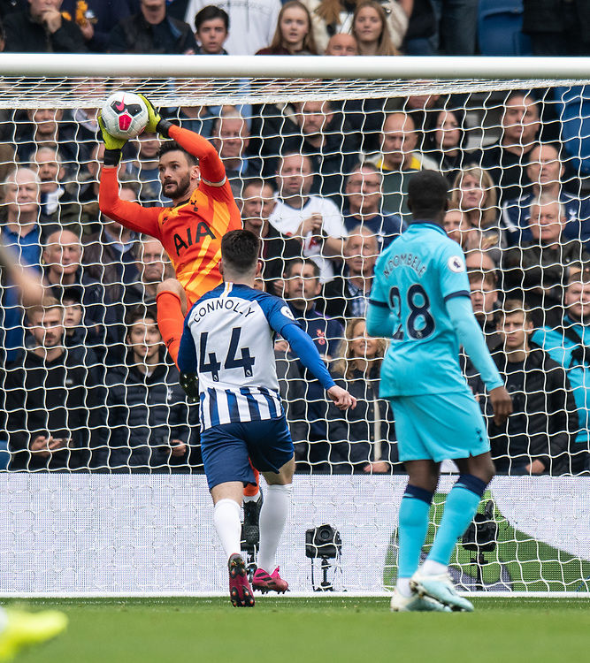 Tottenham Hotspur's Hugo Lloris (left) gets to the ball before dropping it to concede a goal to Brighton & Hove Albion's Neal Maupay <br /> <br /> Photographer David Horton/CameraSport<br /> <br /> The Premier League - Brighton and Hove Albion v Tottenham Hotspur - Saturday 5th October 2019 - The Amex Stadium - Brighton<br /> <br /> World Copyright © 2019 CameraSport. All rights reserved. 43 Linden Ave. Countesthorpe. Leicester. England. LE8 5PG - Tel: +44 (0) 116 277 4147 - admin@camerasport.com - www.camerasport.com