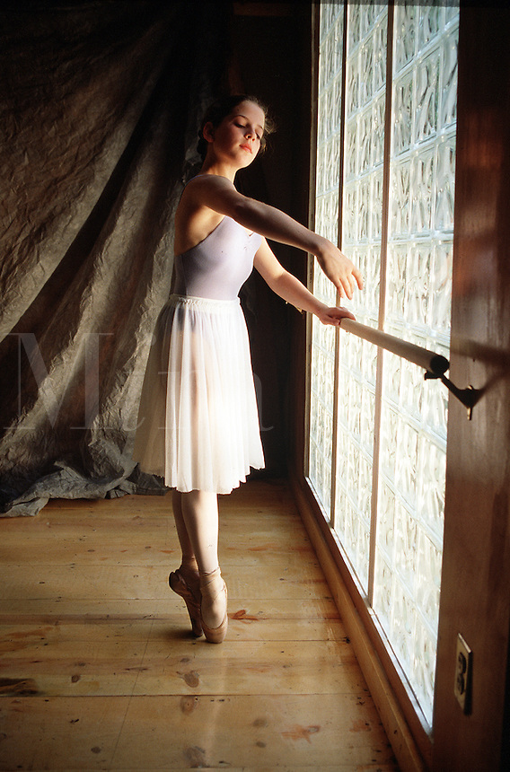 Young ballerina dancing in studio