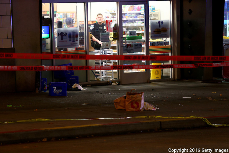 SEATTLE, WA - NOVEMBER 09: Police speak with people inside a 7 Eleven after five people were shot  on November 9, 2016 in Seattle, Washington. (Photo by Karen Ducey/Getty Images)