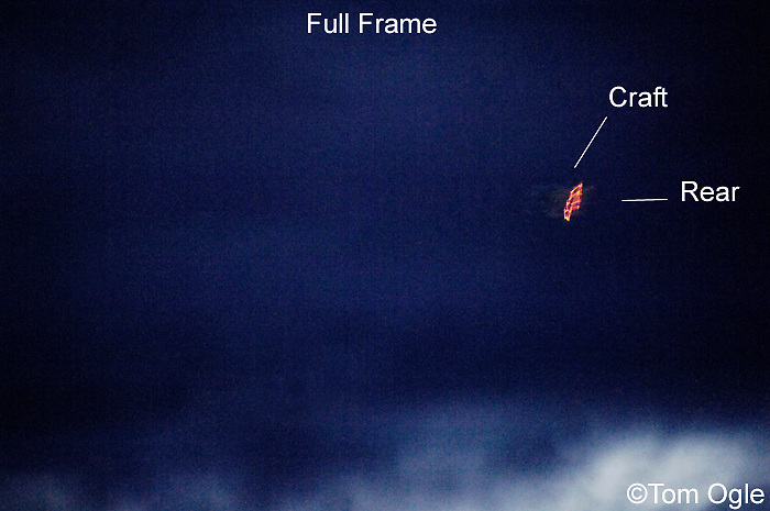 UFO/alien spacecraft on a circuit of Elliott Bay, headed SW and showing illumination from rear/propulsion?  Faint outline of craft is present, denoting saucer shape.