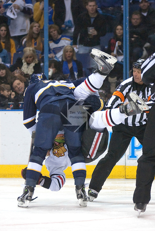 January 2,  2010                     St. Louis Blues left wing David Perron (57, left) slams Blackhawks player Kris Versteeg (32) to the ice in the second period.  The two then scuffled for a moment until referees separated them.  The St. Louis Blues hosted the Chicago Blackhawks on Saturday January 2, 2010 at the Scottrade Center in downtown St. Louis.
