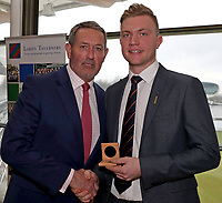 Graham Gooch (L) presents Sam Cook (R) with his County Championship winning medal during the Lord's Taverners Presentation at Lord's Cricket Ground on 12th March 2018