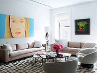 The family room is light and airy and has a relaxed feel. The custom sofa is upholstered in a Castel fabric, above which hangs a painting by Alex Katz.