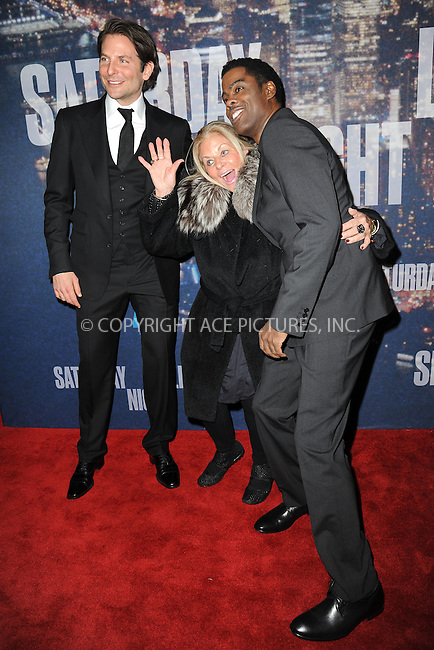 WWW.ACEPIXS.COM<br /> February 15, 2015 New York City<br /> <br /> Bradley Cooper, Gloria Campano, Chris Rock walking the red carpet at the SNL 40th Anniversary Special at 30 Rockefeller Plaza on February 15, 2015 in New York City.<br /> <br /> Please byline: Kristin Callahan/AcePictures<br /> <br /> ACEPIXS.COM<br /> <br /> Tel: (646) 769 0430<br /> e-mail: info@acepixs.com<br /> web: http://www.acepixs.com