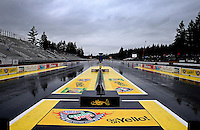 Aug. 2, 2013; Kent, WA, USA: Overall view of the starting line during a rain delay to NHRA qualifying for the Northwest Nationals at Pacific Raceways. Qualifying was cancelled for the day. Mandatory Credit: Mark J. Rebilas-USA TODAY Sports