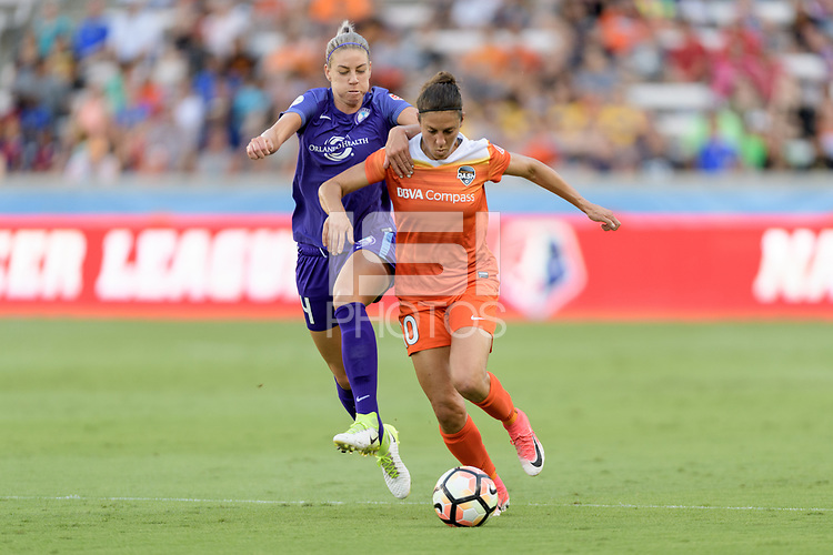 Houston, TX - Saturday June 17, 2017: Alanna Kennedy and Carli Lloyd battle for control of the ball during a regular season National Women's Soccer League (NWSL) match between the Houston Dash and the Orlando Pride at BBVA Compass Stadium.