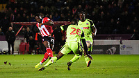 Lincoln City's John Akinde scores his side's fourth goal<br /> <br /> Photographer Chris Vaughan/CameraSport<br /> <br /> The EFL Sky Bet League One - Lincoln City v Bolton Wanderers - Tuesday 14th January 2020  - LNER Stadium - Lincoln<br /> <br /> World Copyright © 2020 CameraSport. All rights reserved. 43 Linden Ave. Countesthorpe. Leicester. England. LE8 5PG - Tel: +44 (0) 116 277 4147 - admin@camerasport.com - www.camerasport.com