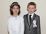 Cousins Jenna Bhatti and Ben Maguire from St Josephs school who recieved first holy communion at St Josephs Church Mell. Photo: Colin Bell/pressphotos.ie