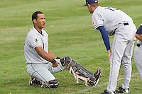 July 8, 2009: Tri-City Dust Devils catcher Jose Gonzalez chats with starting pitcher Dan Perkins prior to a Northwest League game against the Salem-Keizer Volcanoes at Volcanoes Stadium in Salem, Oregon.