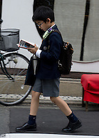 pupil in uniform walking home, Kyoto, Japan
