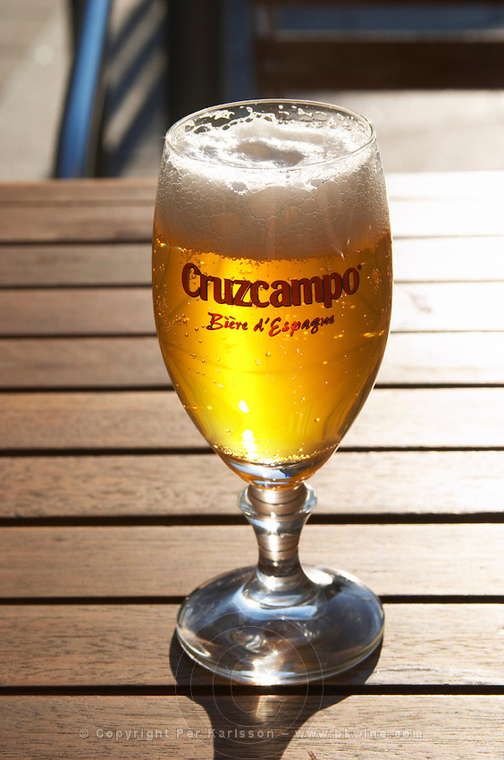 A cafe. Glass of cold beer Cruzcampo. On Cours du Chapeau Rouge. Bordeaux city, Aquitaine, Gironde, France