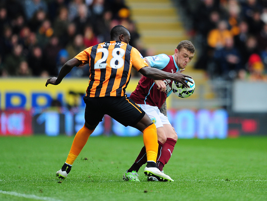 Burnley's Kieran Trippier vies for possession with Hull City's Dame N'Doye<br /> <br /> Photographer: Chris Vaughan/CameraSport<br /> <br /> Football - Barclays Premiership - Hull City v Burnley - Saturday 9th May 2015 - Kingston Communications Stadium - Hull<br /> <br /> &copy; CameraSport - 43 Linden Ave. Countesthorpe. Leicester. England. LE8 5PG - Tel: +44 (0) 116 277 4147 - admin@camerasport.com - www.camerasport.com