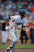 Cedar Rapids Kernels shortstop Jermaine Palacios (4) runs to first base during a game against the Dayton Dragons on May 10, 2017 at Fifth Third Field in Dayton, Ohio.  Cedar Rapids defeated Dayton 6-5 in ten innings.  (Mike Janes/Four Seam Images)
