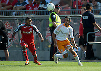 July 28, 2012: Houston Dynamo forward Calen Carr #3 and Toronto FC defender Ashtone Morgan #5 in action during a game between Toronto FC and the Houston Dynamo at BMO Field in Toronto, Ontario Canada..The Houston Dynamo won 2-0.