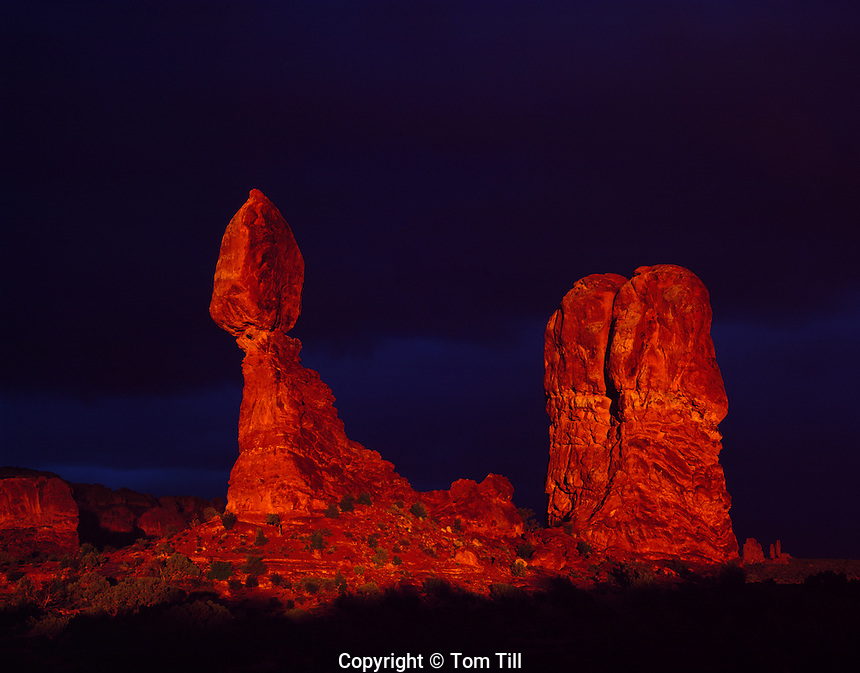 Balanced Rock in stormlight, Arches National Park, Utah  Dark sky from spring thunderstorm